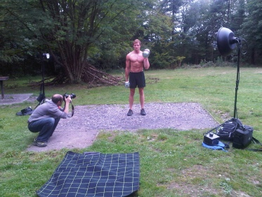 Sean Lerwill curls dumbbells for the Maximuscle shoot